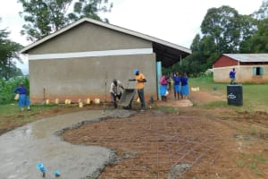 The Water Project: Kimangeti Primary School -  Pouring Cement For Rain Tank Foundation