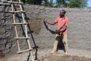 The Water Project: Lwanga Itulubini Primary School -  Cementing Interior Of Tank