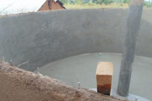 The Water Project: Friends Primary School Givogi -  Peering Into The Tank At The Center Support Column