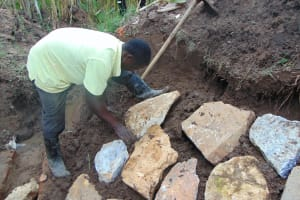 The Water Project: Shihungu Community, Shihungu Spring -  Rub Wall Construction