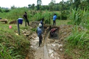 The Water Project: Ikonyero Community, Amkongo Spring -  Excavation Begins