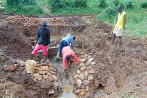 The Water Project: Lutonyi Community, Lutomia Spring -  Rub Wall Construction