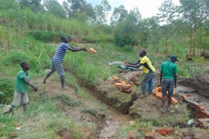 The Water Project: Sasala Community, Kasit Spring -  Community Members Helping Out