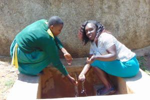 The Water Project: Madegwa Primary School -  Charity And Laura At The Rain Tanks Tap