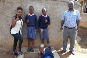 The Water Project: Friends Kaimosi Demonstration Primary School -  Field Officer Georgina Kamau With Students And Mr Musalia