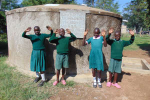The Water Project: Mavusi Primary School -  Happy Faces At The Rain Tank