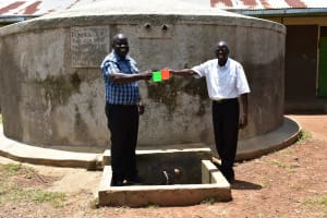 The Water Project: Mukunyuku RC Primary School -  Head Teacher Mr Wesonga And School Board Chair Enjoying Some Water