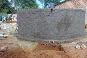 The Water Project: Lwanga Itulubini Primary School -  Rain Tank With Fresh Cement