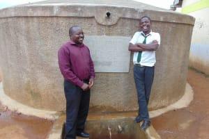 The Water Project: Precious School Kapsambo Secondary -  Mr Sandagi With A Student Enjoying A Laugh