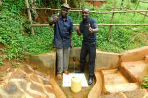 The Water Project: Asimuli Community, John Omusembi Spring -  John Omusembi With Field Officer Wilson Kipchoge