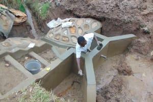 The Water Project: Shihungu Community, Shihungu Spring -  Plaster Works