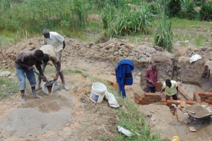 The Water Project: Ikonyero Community, Amkongo Spring -  Community Members Helping Out