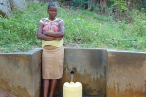 The Water Project: Upper Visiru Community, Wambosani Spring -  Agnes Lidambiza Fetches Water