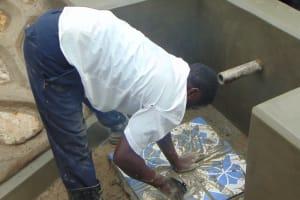The Water Project: Shihungu Community, Shihungu Spring -  Tile Setting