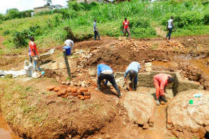 The Water Project: Lutonyi Community, Lutomia Spring -  Construction Continues
