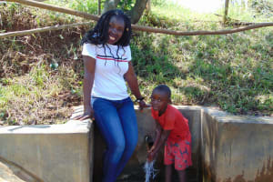 The Water Project: Mungaha B Community, Maria Spring -  Field Officer Laura With Dunstone