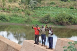 The Water Project: Masola Community A -  Standing At The Dam With Water Gathered Behind