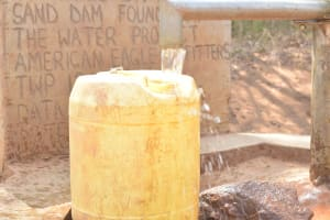 The Water Project: Katuluni Community B -  Container Fills Up With Water