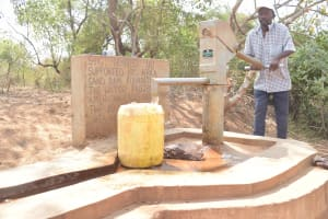 The Water Project: Katuluni Community B -  Filling Up Container At The Well A Year Later