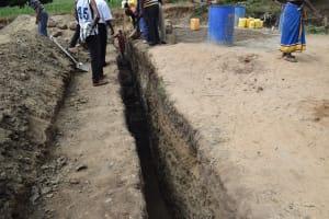 The Water Project: Kaukuswi Community -  Dam Construction Phase One