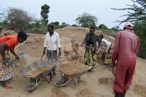 The Water Project: Kaukuswi Community -  Hauling Sand