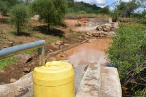 The Water Project: Maluvyu Community G -  Container Fills With Water From The Well