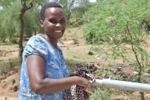 The Water Project: Maluvyu Community G -  Happy To Have The Completed Well