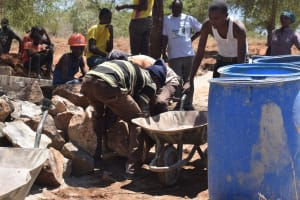 The Water Project: Maluvyu Community G -  Hauling Rocks