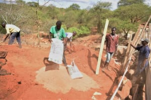 The Water Project: Maluvyu Community G -  Pouring Cement To Mix