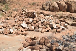 The Water Project: Maluvyu Community G -  Rocks For Construction