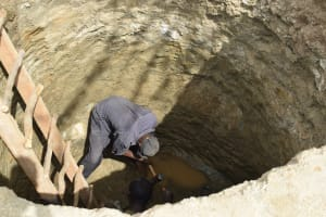 The Water Project: Kaukuswi Community A -  Digging Out Well