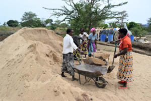 The Water Project: Kaukuswi Community A -  Hauling Sand