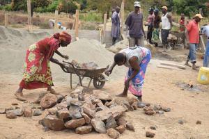 The Water Project: Kaukuswi Community A -  Loading Up Rocks