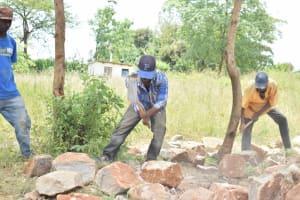 The Water Project: Kyamatula Secondary School -  Breaking Large Rocks