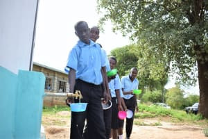 The Water Project: Kyamatula Secondary School -  Collecting Water