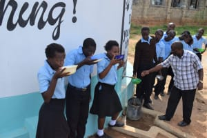 The Water Project: Kyamatula Secondary School -  Drinking Water From The Tank