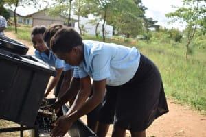 The Water Project: Kyamatula Secondary School -  Girls Using Handwashing Station