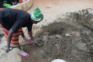 The Water Project: Kamulalani Primary School -  Scooping Cement