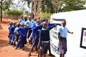 The Water Project: Kamulalani Primary School -  Students Point To The New Tank