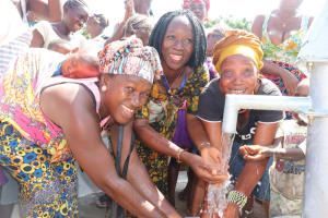 The Water Project: 45 Main Motor Road, The Redeemed Christian Church of God -  Councilor Fatmata Akai And Two Community Women Celebrating At The Spring