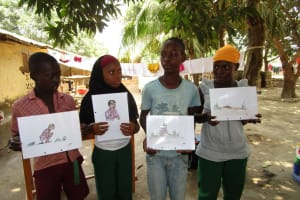 The Water Project: Tholmossor, Masjid Mustaqeem, 18 Kamtuck Street -  Children Holding Posters