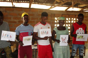 The Water Project: Lungi, Rotifunk, King Fuad Hafis Islamic School -  Community Members Displaying Disease Transmission Posters