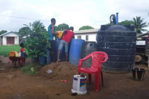 The Water Project: Lungi, Rotifunk, King Fuad Hafis Islamic School -  Community Members Fetch Water For Drilling