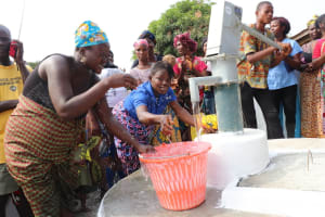 The Water Project: Targrin Health Post -  Drinking From The Well