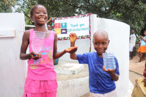 The Water Project: Lungi, Suctarr, 10 Khalil Lane -  Kids Drinking Weater From The Well