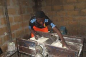 The Water Project: Lungi, Masoila, #3 Kamara Street -  Mixing Flour
