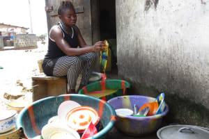 The Water Project: Lungi, Masoila, #3 Kamara Street -  Woman Cleaning Dishes