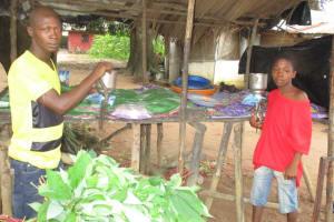 The Water Project: Lungi, Masoila, #3 Kamara Street -  Young Men Grind Casava Leaves