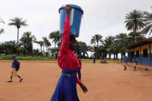 The Water Project: Lungi, Lungi Town, Holy Cross Primary School -  Carrying Water