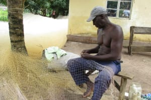 The Water Project: Lungi, Lungi Town, Holy Cross Primary School -  Old Man Making Fishing Net